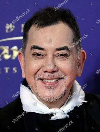 Hong Kong actor Anthony Wong poses on the red carpet of the Asian Film Awards in Hong Kong