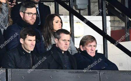 Kenny Dalglish looks on