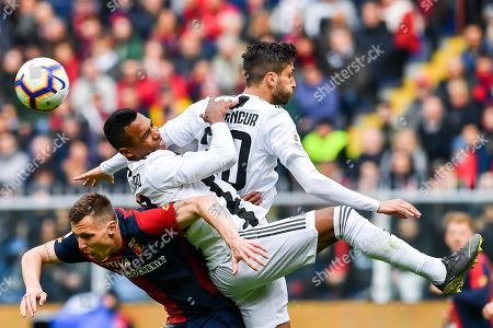 Genoa's Danish midfielder Lukas Lerager (L) vies for the ball with Juventus players, Alex Sandro (C) and Rodrigo Bentancur (R) during the Italian Serie A soccer match Genoa Cfc vs Juventus Fc at Luigi Ferraris Stadium in Genoa, Italy, 17 March 2019.