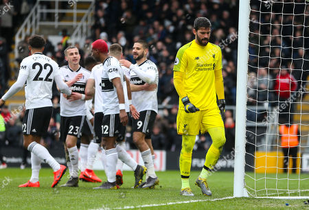 A dejected Liverpool goalkeeper Alison Becker after his mistake led to an equalising goal