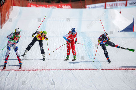 France Alizee Baron (green bib) leads ahead Canada's Kelsey Serwa (yellow bib), Switzerland's Fanny Smith (red bib) and Canada's Brittany Phelan (blue bib) during the semi final of the Ladies' Ski Cross, at the FIS Ski Cross World Cup Finals, in Veysonnaz, Switzerland, Sunday, March 17, 2019.