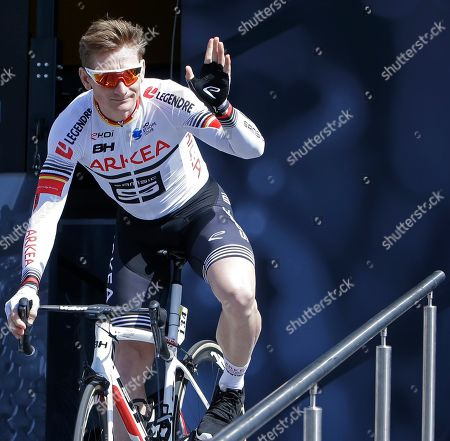 German sprinter Andre Greipel waves to spectators prior to the start of the eighth stage of the Paris Nice cycling race with start and finish in Nice, southeastern France