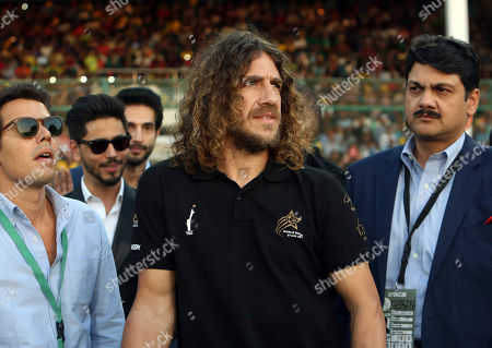 Stock Image of Retired Barcelona soccer player Carles Puyol, center, arrives to attend the closing ceremony of the Pakistan Super League, prior to the final cricket match at National stadium in Karachi, Pakistan, . Peshawar Zalmi will play in the final against Quetta Gladiator