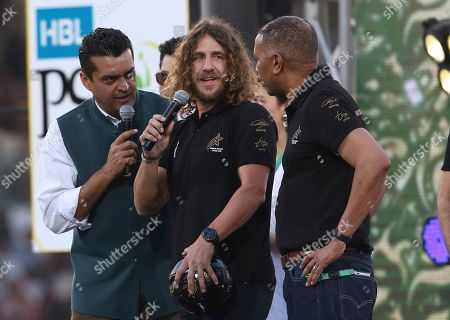 Retired Barcelona soccer player Carles Puyol, center, attends the closing ceremony of the Pakistan Super League, prior to the final cricket match at National stadium in Karachi, Pakistan, . Peshawar Zalmi will play in the final against Quetta Gladiator