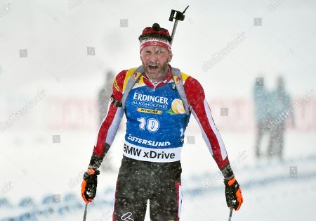Stock Image of Simon Eder of Austria reacts after crossing the finish line during the men's 15km Mass Start race at the IBU Biathlon World Championships in Oestersund, Sweden, 17 March 2019.