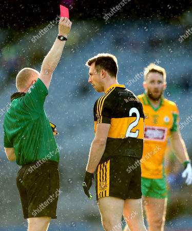 Stock Image of Corofin vs Dr. Crokes. Dr. Crokes' John Payne red carded by referee Barry Cassidy