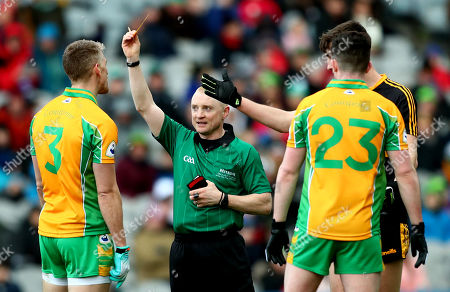 Corofin vs Dr. Crokes. Corofin's Kieran Fitzgerald receives his second yellow card before being sent off by referee Barry Cassidy