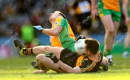 Stock Photo of Corofin vs Dr. Crokes. Dr. Crokes' John Payne collides with Dylan Wall of Corofin, the collision resulted in a straight red card