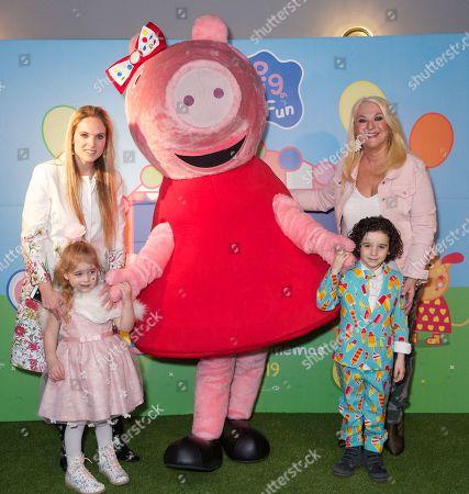 Stock Image of Allegra Kurer with children Zeke and Neroli and Vanessa Feltz