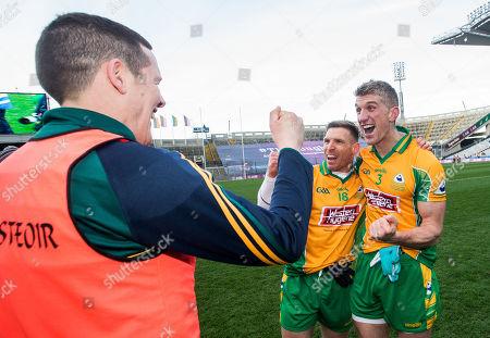 Corofin vs Dr. Crokes. Corofin's Kieran Fitzgerald celebrates after the game with manager Kevin O'Brien and Ciaran McGrath