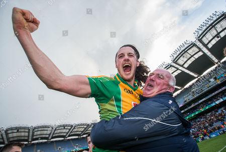 Stock Picture of Corofin vs Dr. Crokes. Corofin's Kieran Molloy celebrates after the game with goalkeeper coach Joe Power