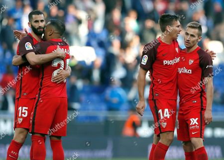 (L-R) Sevilla FC's players Maxime Gonalons, Gabriel Mercado, Maximilian Wober and Marko Rog celebrate the team's victory on a Spanish LaLiga soccer match between RCD Espanyol and Sevilla FC at the RCDE Stadium in Barcelona, northern Spain, 17 March 2019.