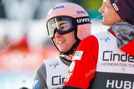 Stefan Kraft (L) of Austria reacts during the Flying Hill event of the FIS Ski Jumping World Cup in Vikersund, Norway, 17 March 2019. Kraft took the third place.