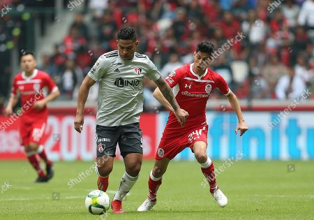 Toluca's Pablo Barrientos (R) vies for the ball with Atlas' Anderson Santamaria during their Mexican tournament soccer match between Toluca and Atlas at Nemesio Diez stadium in Toluca, Mexico, 17 March 2019.