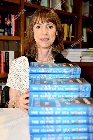 """Author Lisa See poses for portrait after speaking and signing copies of her new book """"The Island of Sea Women"""" at Books and Books Gables"""