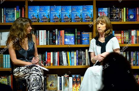 """Stock Picture of Claudia Potamkin in a conversation with author Lisa See during the signing of her new book """"The Island of Sea Women"""" at Books and Books Gables"""