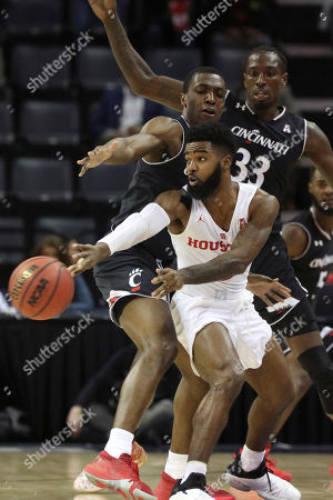 Cincinnati's Keith Williams and Nysier Brooks (33) defend against Houston's Corey Davis Jr. during the first half of the NCAA college basketball game for the American Athletic Conference men's tournament championship, in Memphis, Tenn