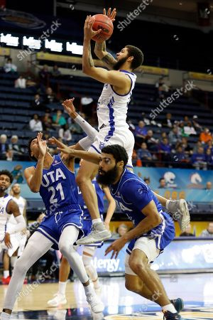 Georgia State guard D'Marcus Simonds (15) goes up to the basket in between Texas-Arlington guard Pedro Castro (21) and guard Brian Warren (0) during the second half of the NCAA college basketball championship game of the Sun Belt Conference men's tournament in New Orleans, . Georgia State won 73-64