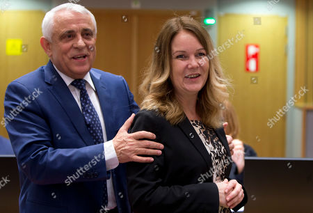 Sweden's Agriculture Minister Jennie Nilsson, right, poses with Romanian Agriculture Minister Petre Daea at the EU Council building in Brussels