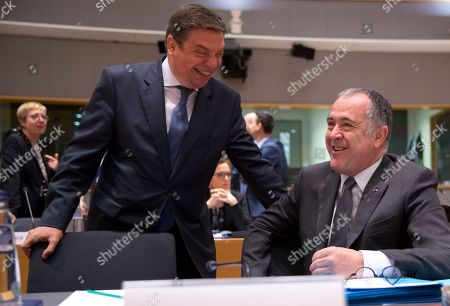 Spain's Agriculture Minister Luis Planas Puchades, left, speaks with French Agriculture Minister Didier Guillaume during a meeting of EU agriculture ministers at the EU Council building in Brussels