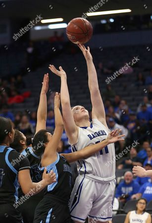 Kathleen Duran, Olyanda Fernando. Caruthers' Kathleen Duran, right, goes up for the shot against Ramona's Olyanda Fernando, left during the second half of the CIF Girls Division V State High School Basketball Championships, in Sacramento, Calif. Caruthers won 62-38