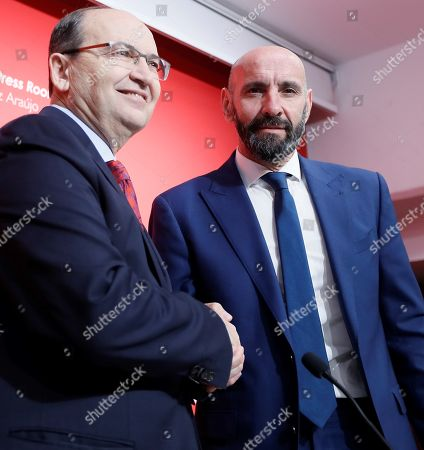 Sevilla FC's President Jose Castro (L) shakes hands with Ramon Rodriguez Verdejo 'Monchi' (R) during his presentation as new Sport General Manager held at Sanchez Pizjuan stadium, in Seville, southern Spain, 18 March 2019.