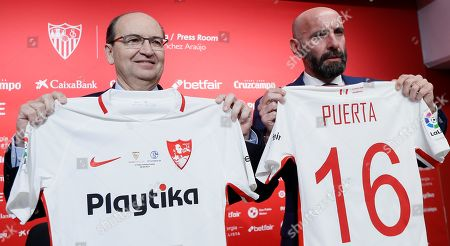 Sevilla FC's President Jose Castro (L) poses with Ramon Rodriguez Verdejo 'Monchi' (R) during his presentation as new Sport General Manager held at Sanchez Pizjuan stadium, in Seville, southern Spain, 18 March 2019.