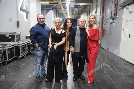 Cristel Carrisi is with her sister Romina and Lino Banfi with their children Walter and Rossana