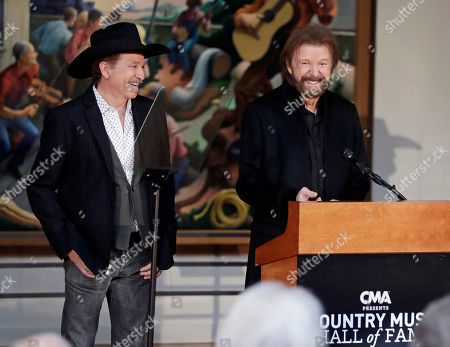 Ronnie Dunn, Kix Brooks. Kix Brooks, left, and Ronnie Dunn, of the duo Brooks and Dunn, appear during the annual announcement of inductees into the Country Music Hall of Fame, in Nashville, Tenn. They will be inducted along with Ray Stevens and Jerry Bradley