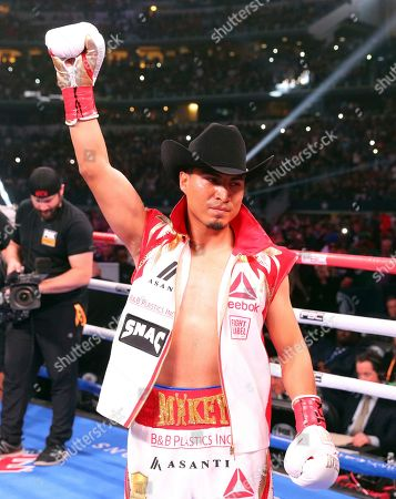 Mikey Garcia gestures for the crowd before an IBF World Welterweight Championship boxing bout against Errol Spence Jr., in Arlington, Texas