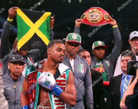 Errol Spence Jr, gestures for a TV camera before an IBF World Welterweight Championship boxing bout against Mikey Garcia, in Arlington, Texas