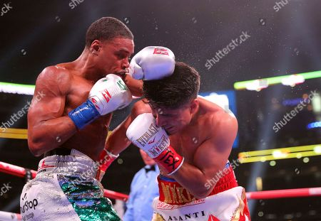 Errol Spence Jr., left, fights Mikey Garcia, right, in an IBF World Welterweight Championship boxing bout, in Arlington, Texas