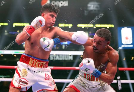 Mikey Garcia, left, fights Errol Spence Jr., right, in an IBF World Welterweight Championship boxing bout, in Arlington, Texas