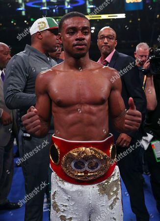 Errol Spence Jr. poses for a photo after defeating Mikey Garcia in an IBF World Welterweight Championship boxing bout, in Arlington, Texas