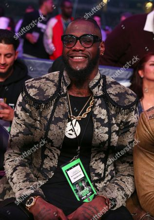 Deontay Wilder, sits ringside before the IBF World Welterweight Championship boxing bout between Errol Spence Jr. and Mikey Garcia, in Arlington, Texas