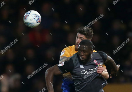 Lincoln City's John Akinde battles with Mansfield Town's Ryan Sweeney