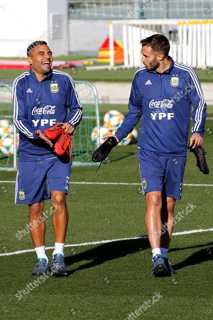 Argentina's Gabriel Mercado (L) and Tagliafico (R) attend a training session of the team at Valdebebas sports complex in Madrid, Spain, 18 March 2019. Argentina will face Venezuela on 22 March 2019 on an International friendly soccer match in Madrid.