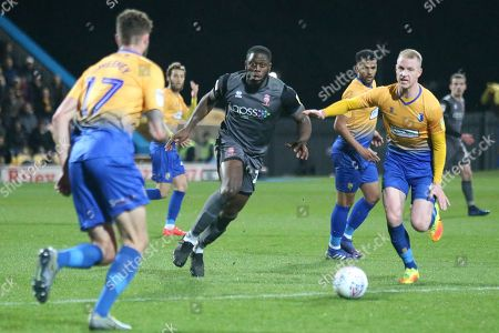 John Akinde of Lincoln City (29) chases a through ball but is stopped by Ryan Sweeney of Mansfield Town (17) during the EFL Sky Bet League 2 match between Mansfield Town and Lincoln City at the One Call Stadium, Mansfield