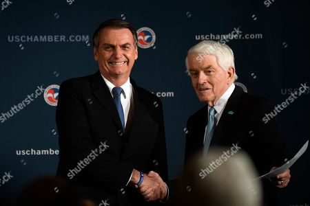 Stock Photo of Jair Bolsonaro, Thomas Donohue. Brazilian President Jair Bolsonaro, left, shakes hands with Chamber of Commerce President and Chief Executive Officer Thomas Donohue, right, as he arrives on stage before speaking at the Chamber of Commerce in Washington