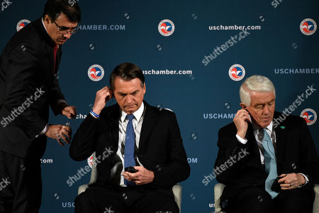 Stock Picture of Jair Bolsonaro, Thomas Donohue. Brazilian President Jair Bolsonaro, center, and Chamber of Commerce President and Chief Executive Officer Thomas Donohue, right, gets prepared to speak at the Chamber of Commerce in Washington