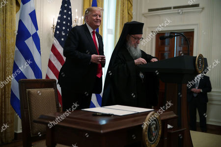 US President Donald J. Trump (L) participates with Archbishop Demetrios (R), Geron of America, in a Greek Independence Day celebration at the East Room of the White House in Washington, DC, USA, 18 March 2019.