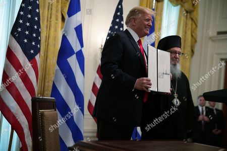 US President Donald J. Trump and Archbishop Demetrios, Geron of America, participate in a Greek Independence Day celebration at the East Room of the White House in Washington, DC, USA, 18 March 2019.