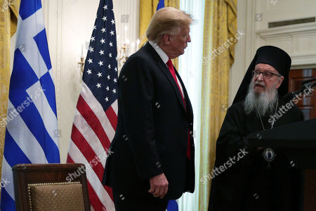 US President Donald J. Trump listens as Archbishop Demetrios, Geron of America, speaks during a Greek Independence Day celebration in the East Room of the White House in Washington, DC, USA, 18 March 2019.
