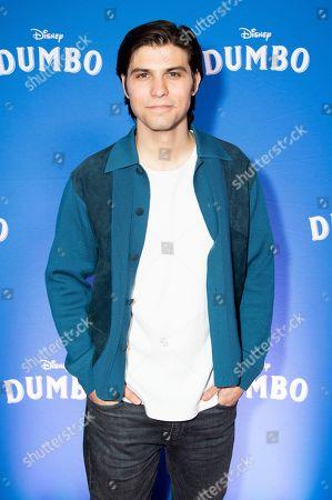 "Luke Bilyk poses at the Canadian premiere of ""Dumbo"", in Toronto"