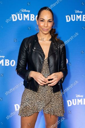 "Amanda Brugel poses at the Canadian premiere of ""Dumbo"", in Toronto"