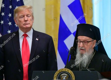 United States President Donald J. Trump, left, listens as Archbishop Demetrios of America, right, Geron of America, makes remarks during the Greek Independence Day Celebration in the East Room of the White House.