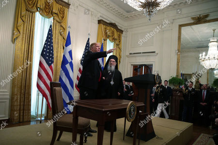 United States President Donald J. Trump (L) and Archbishop Demetrios of America, Geron of America, participate in a Greek Independence Day celebration at the East Room of the White House.