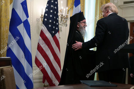 United States President Donald J. Trump and Archbishop Demetrios of America, Geron of America, participate in a Greek Independence Day celebration at the East Room of the White House.