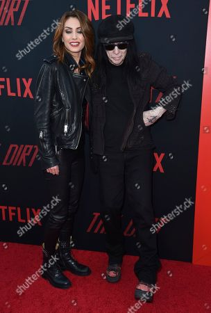 """Fai McNasty, Mick Mars. Fai McNasty, left, and Mick Mars arrive at the world premiere of """"The Dirt"""", at ArcLight Hollywood in Los Angeles"""