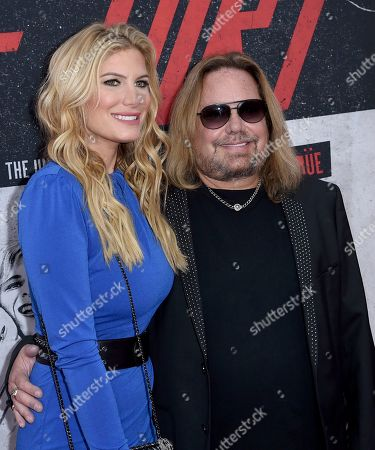 """Stock Photo of Vince Neil, Rain Andreani. Vince Neil, right, and Rain Andreani arrive at the world premiere of """"The Dirt"""", at ArcLight Hollywood in Los Angeles"""